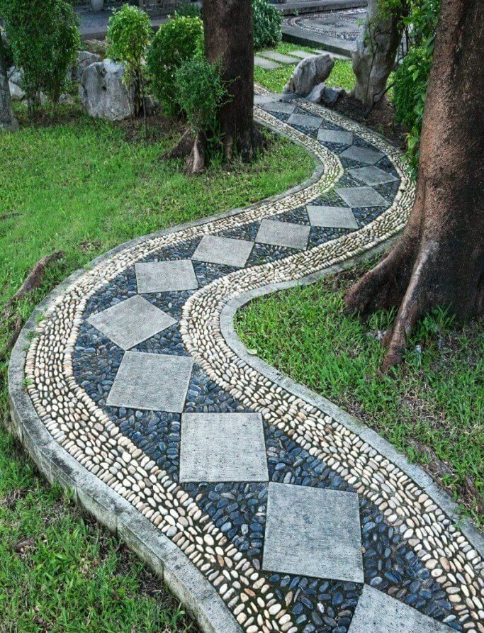 curved mosaic pathway backyard landscaping