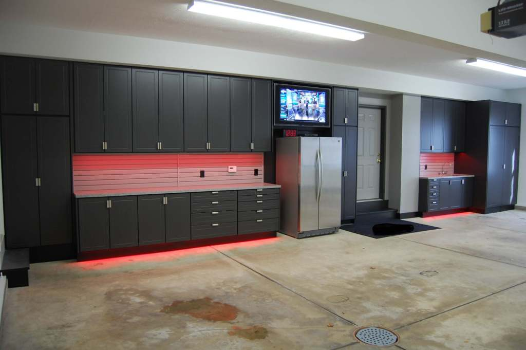 garage design with concrete garage floor and garage storage or garage cabinet