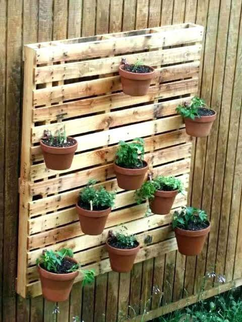 outdoor mounted plant stand from pallets