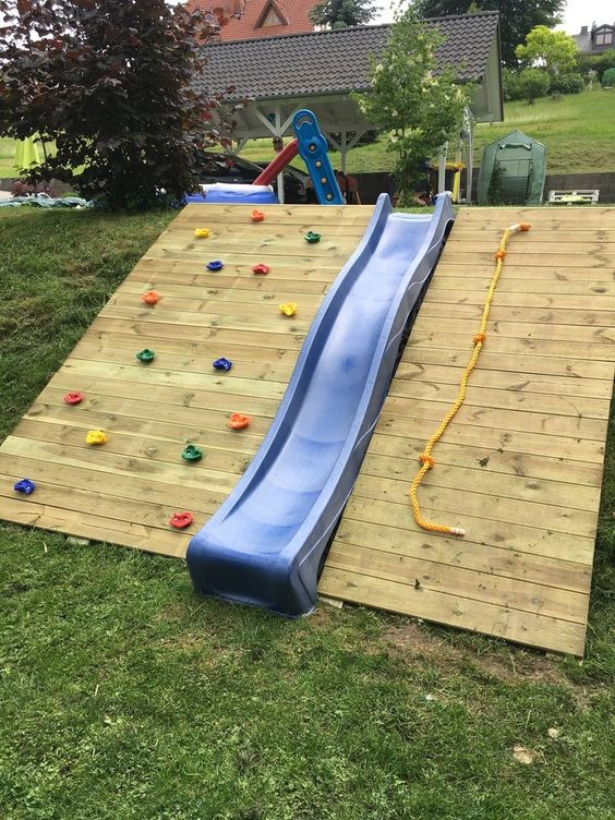 Rock Climbing with Slide - Backyard Playground landscaping ideas