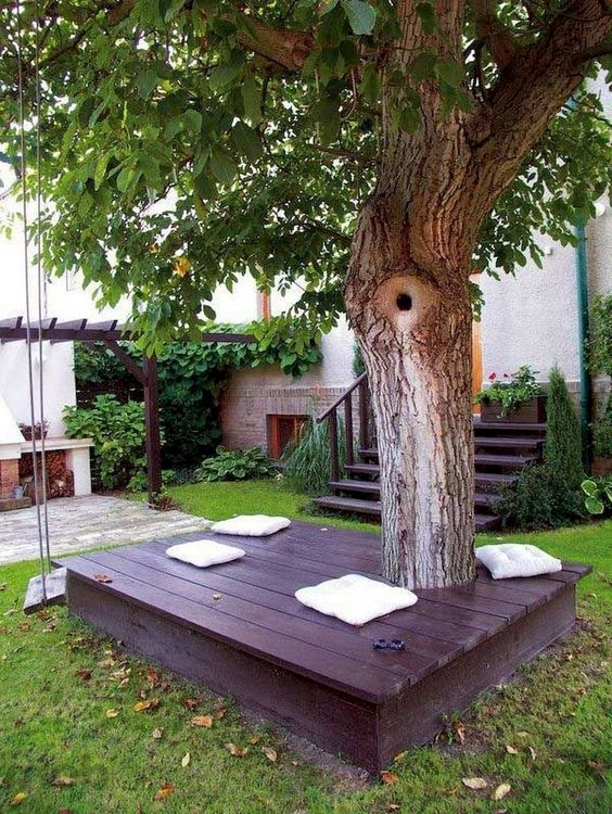 Wooden lounge under the tree - backyard playground ideas